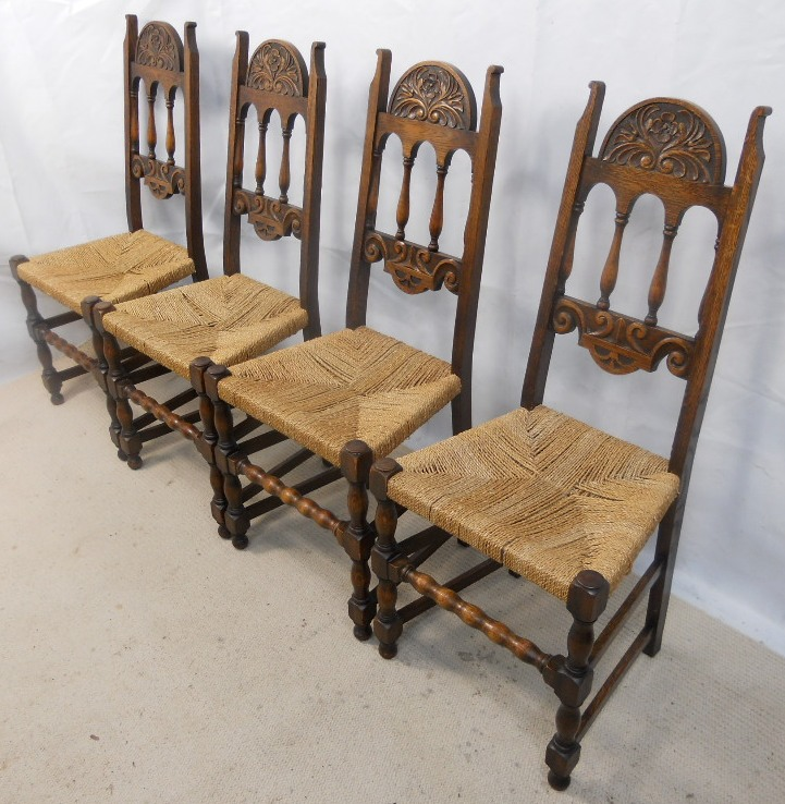 Set Of Four Carved Oak Highback Dining Chairs SOLD